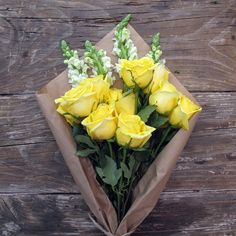 Yellow roses and snapdragon accents