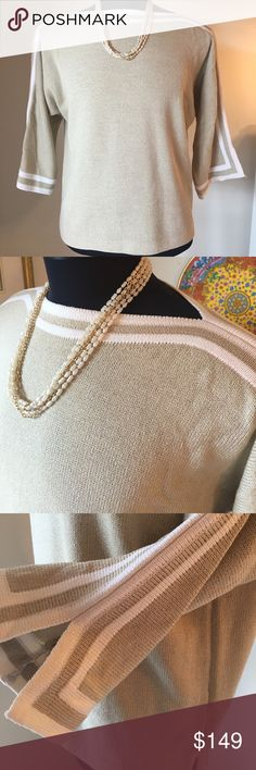 ⭐️ST. JOHN STUNNING SWEATER 💯AUTHENTIC ST . JOHN SPORT LOVELY SWEATER! 100% AUTHENTIC. STUNNING AND STYLISH TOTALLY ON TREND! SO BEAUTIFUL! THE COLORS ARE TAN AND WHITE. THE SIZE IS MEDIUM. THIS IS TRUE HIGH END LUXURY! THE BUST IS 23 INCHES ACROSS AND 46 INCHES AROUND St. John Sweaters