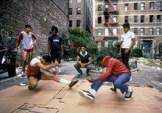 B-boys on cardboard - by Martha Cooper