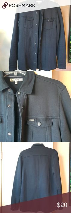 Calvin Klein XS Hunter Green Jacket w/ snap button Calvin Klein XS Hunter Green Jacket w/ snap button. Width is 18 inches across or 36 around. Length is 28 inches long. Has two small breast pockets.  100% Cotton. Calvin Klein Jackets & Coats Jean Jackets