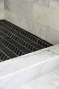 Carrara marble shower tile with black chevron shower floor tile 12 x View our range at www. Shower Floor Tile, Ceramic Floor Tiles, Custom Home Builders, Custom Homes, Painted Brick Exteriors, Marble Showers, Fancy Houses, Minimalist Decor, Tile Design
