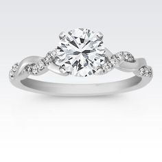 I like the twist sides of the band and solitaire diamond