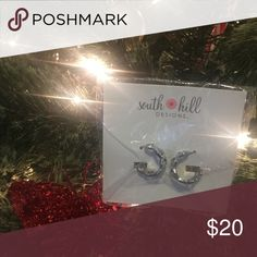 Silver Octagonal Earrings with Crystals The Silver Tone Octagonal Earrings with Crystals pair gorgeous bling with fashion-forward geometric styling. Wear these eye-catching creations with all your favorite outfits for a trendsetting look. Jewelry Earrings