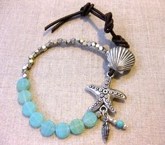 The perfect coastal bracelet! A strand of matte aqua glass beads that look like gorgeous seaglass mixed with silver nuggets. Combine with a fun