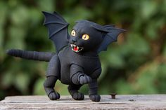 The doll is 6,5 cm  ____________________  Mold: Kitten Size: 6,5 cm Color: Black, Gradient: - Airbrushing: Gray (inner of the ears and wings) Head options - Head: Grin (yellow thin) Tail: Long Wings: Bat