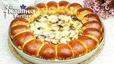 Doyuran Pizza Tarifi nasıl yapılır? Doyuran Pizza Tarifi'nin malzemeleri, resimli anlatımı ve yapılışı için tıklayın. Yazar: Sümeyra Temel