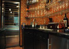 Stunning wallpaper, huge wine fridge, open glass shelves. Kingwood Remodeling MHR Modern Home Renovation in Kingwood, Texas 77339
