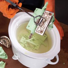 Remove old paint from metal: A long, hot, sudsy soak in a crockpot with water and a bit of liquid detergent to break the paint bond. More often than not, you can slide all the cooked paint layers off with your fingers. A scrubbing with a nylon brush removes the stubborn bits. A beeswax furniture polish after stripping, or a nonabrasive polish like Flitz or Maas can restore the sheen to solid brass or thickly plated hardware.