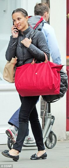 The Duchess of Cambridge's younger sister, 31,  brandished a large beige handbag, a sports bag and a large red Longhamp tote