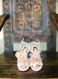 this entire wedding is crazy romantic right down to these petaled shoes by http://www.badgleymischka.com/  Photography by http://kurtboomerphoto.com