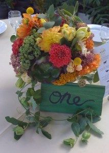 Gorgeous and Green Succulent dahlias centerpiece for a summer wedding at Flora Grubb Gardens in San Francisco.  Featuring local dahlias, celosia, passion vine, sustainable parrot tulips, scabiosa pods and billy balls.  http://gorgeousandgreenevents.com