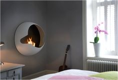 Wall mounted fireplace. Easy to install as a flat screen TV, no flue needed!
