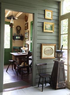 "love framed prints on a paneled wall...Don Didier's home in New Orleans. Sept. ""The Magazine Antiques"", 2011"