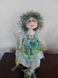 Charlie Patricolo-cloth doll maker. I love the clothes. Notice the burned edges to her skirts. Nice!