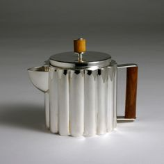 Ilonka Karasz (1896–1981), American (born Hungary) / art deco teapot with ribbed or fluted sides, electroplated nickel silver, walnut wood handles and knob, made by Paye & Baker Manufacturing Company, c. 1928, USA