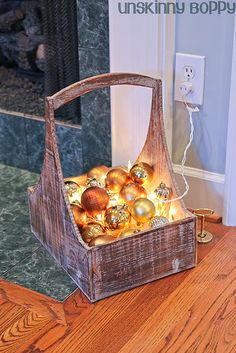 glowing ornaments in a basket- white lights underneath a pile of ornaments