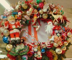 """Christmas wreaths from """"found"""" decorations at your favorite resale or thrift shop. Or use your children's abandoned toys to create one that's all about you!"""