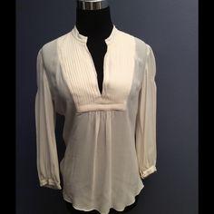 Trina Turk silk blouse Beautiful Trina Turk medium creamy white silk blouse. So soft and silky what a beautiful timeless piece! Trina Turk Tops