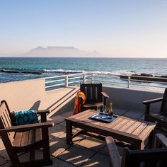 When you stay at Bokkombaai Tides you don't even need to leave the house in order to see Cape Town's biggest gem: Table Mountain! Table Mountain, Cape Town, Outdoor Furniture, Outdoor Decor, Sun Lounger, Gem, Magic, City, House