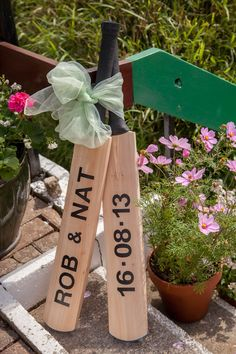Personalised cricket bats for our wedding x