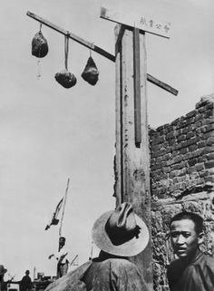 Anti-Japanese Manchurians' severed heads displayed in Harbin, Manchukuo. Described as 'mutineers' by the Japanese occupiers of Manchuria, the heads were hung in old Chinese quarter of the city. Ca. Nov. 1937.