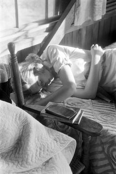 Photo: Saul Leiter (one of the books is Henry James' What Maisie Knew; was Leiter a James fan?).