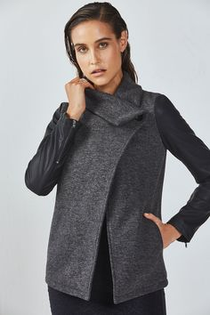 This faux leather-sleeve coat lets you cover up in the coolest way possible. Its stand-up ribbed collar and cozy, fleece fabric are what cold-weather dreams are made of.
