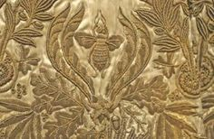 Detail on Napoleon's coronation robe shows a bee, which he took as a symbol power.
