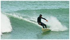 Surfing at Lyall Bay, Wellington, New Zealand