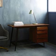 Made from richly-grained solid mango wood and lofted on blackened metal legs, our Industrial Storage Desk creates a spot for writing, reading or catching up on email, for the perfect home office or handy vanity. Modular Home Office Furniture, Modern Home Office Desk, Mango Wood Furniture, New Furniture, Pc Table, Mid Century Modern Desk, Desk Storage, Interior Design, Home Decor