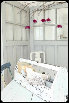 Pop of color in the white-on-white scheme.  Plus, those are old doors