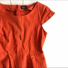 """Kate Spade Saturday Orange Shift Dress From the discontinued Kate Spade Saturday line. Bright orange shift dress with white specks throughout. Cap sleeves and zip back. Asymmetrical front hem. Great condition.   Size: 8 Length: 31.5""""- 34.5"""" Bust: 35""""-36"""" Waist: 30"""" Hips: 40"""" kate spade Dresses Asymmetrical"""