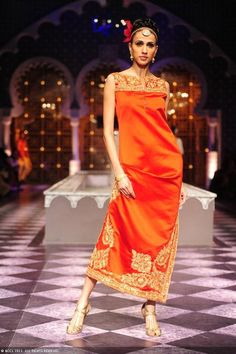 Alecia Raut displays a creation by designer Raghavendra Rathore on Day 3 of India Bridal Fashion Week in New Delhi on July 25, 2013