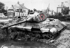 Tiger II wreck. Tank #11 of the Panzer-Kompanie (Funklenk) 316. This tank ran out of fuel & was abandoned on the Boulevard Kellermann at Chateaudun on the night of August 16/17. This Tiger II was penetrated on the left turret side. (Shown). Coated with zimmerit was painted with the standard yellow-olive base coat. The turret numbers were painted in white in the forward section of the turret side. (Pic 3 of 3).