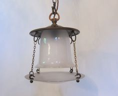 Unusual English pendant light with an Arts and Crafts feel, in the original patinated brass finish, and two part satin glass shade.  www.antiquelightingcompany.com