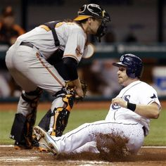 Tampa Bay Rays' Evan Longoria slides safely in ahead of the tag by Baltimore Orioles catcher Matt Wieters during the seventh inning of a baseball game, Monday, Oct. 1, 2012, in St. Petersburg, Fla. Longoria scored on a sacrifice fly by Ben Francisco off Orioles starting pitcher Wei-Yin Chen.