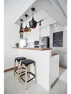 White, concrete, black and copper kitchen.
