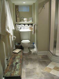 I like the hooks on the wall for towels.  Basement Bathroom. I like the layout