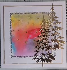 S & D Card Crafts Here I have used the Tim Holtz trees the coloured background is a watery square then i dripped on water colour paint.