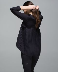 Lululemon Pleat On Long Sleeve in Black (or White)  This long-sleeve top has you covered when you're leaving class. The structured, fitted front is made with sweat-wicking Spacer fabric while the airy, loose back gives you room to breathe. Business in the front, party in the back, function all around.
