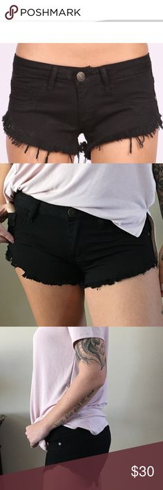 """Black Frayed Denim Cut-Offs Best black cut-offs ever..stretch denim mini shorts..frayed edges to give that distressed look..shorter on the sides to elongate your legs...but definitely enough coverage in back..faux front pockets/functional back pockets...fun, yet sexy shorts that no matter what you wear with them they will still look good..plenty of stretch..true to size...Price firm.  💕I'm 5'7"""" modeling the size M 💕98%Cotton\2%Spandex 💕Waist laying flat: S(14"""") M(15"""") L(16"""") 💕Inseam…"""