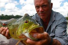 Jeremy Wade with a peacock bass, caught on the Courantyne River of northern South America. A notoriously ferocious hunter, the peacock bass will often damage or even destroy fishing gear with its powerful strike.