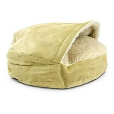 The Cozy Cave Dog Bed has a sheepskin pocket designed so that dogs can snuggle within the comfort of a faux sheepskin pocket.   A support keeps the top cover in place so it can be easily entered.    The Cozy Cave Dog Bed features a washable poly-cotton fabric for the top outside fabric, bottom and sidewall.   Faux lamb's wool top and inside cover, sturdy brass zipper on the outside cover and inside liner of this dog bed is filled with fine spun polyester and cedar.