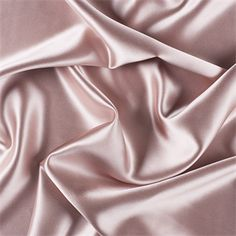 Solid Nude (pink beige) Silk Crepe Back Satin FabricTop of the line silk with a high sheen, similar to charmeuse only heavier and more luxurious. Top side is shiny; back side which is crepe has a fine rib and pebble look and feel. Both sides can be used for textural effects. A superb choice for bridal or the most elegant evening wear.40MMCompare to $67.48 a yardFabric is reorderable as neededPlease allow 3-5 business days before it ships1 YARD MINIMUM CUTNO SAMPLES ARE AVAILABLE