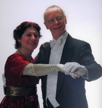"""Arduina Alonzo and Michel Landry, Dance Mistress and Master for the JASNA 2014 Ball. """"Sir Thomas and Lady Bertram request the pleasure of your company at a ball to honour their nephew and niece Midshipman William Price and Miss Price at nine o'clock in the evening on Saturday, October 11th, 2014, The Grand Ballroom, Le Centre Sheraton, Montréal. R.S.V.P. by September 2014, Mansfield Park, Northamptonshire."""""""