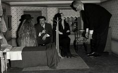 The Addams family in a small room.