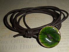 my work..adjustable coconut shell button on American leather wrap...slip knot closure