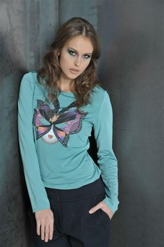 Green blouse with carneval mask print