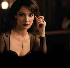 Severine in Skyfall...I am absolutely OBSESSED with this look. The dress, the hair, the plum nails and lips, the smoky eyes...it's just fantastic...