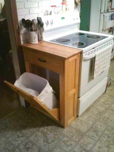 10 Ways to Squeeze Furniture Into Small Spaces - Hidden Tilt Out Trash